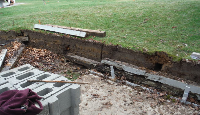 tear out old retaining wall